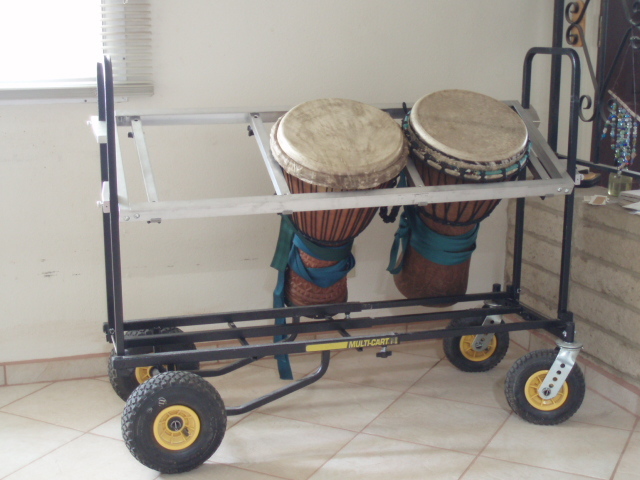 This system was commissioned by Emmy Ayafor. He wanted the ability to play multiple drums with fast set-up and easy mobility. The aluminum rack snaps into place with spring pins and the cross pieces are adjustable for drums of different diameters.